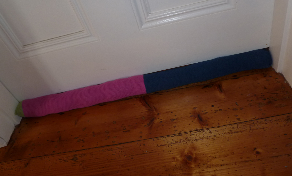 Lumpy door sausages or when form and function fail to for Door gap filler